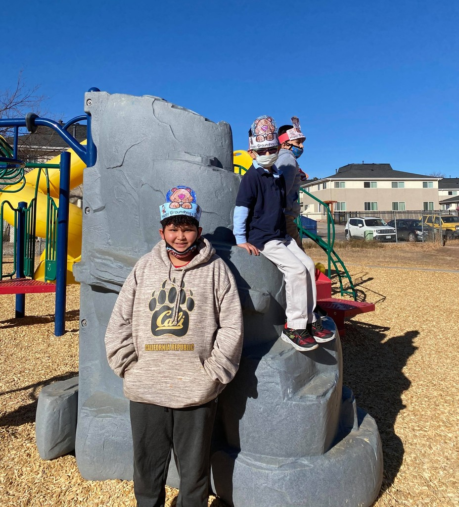 3 boys on playground equipment